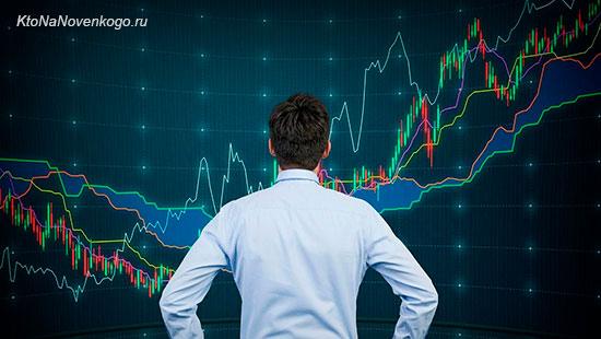 Человек смотрит на графики торгов на фондовой бирже